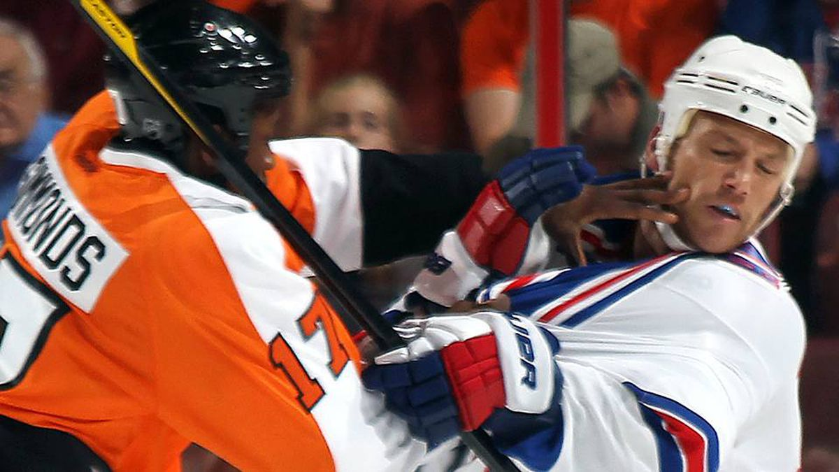 Sean Avery of the New York Rangers is hit by Wayne Simmonds of the Philadelphia Flyers during an NHL preseason game at Wells Fargo Center.