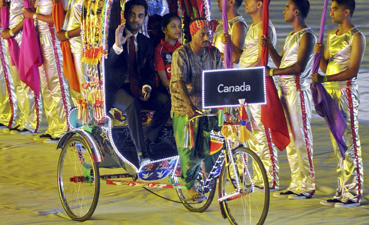 Canada's captain Ashish Bagai arrives on a rickshaw at the opening ceremony of the International Cricket Council (ICC) Cricket World Cup at the Bangabandhu National Stadium in Dhaka, February 17, 2011.