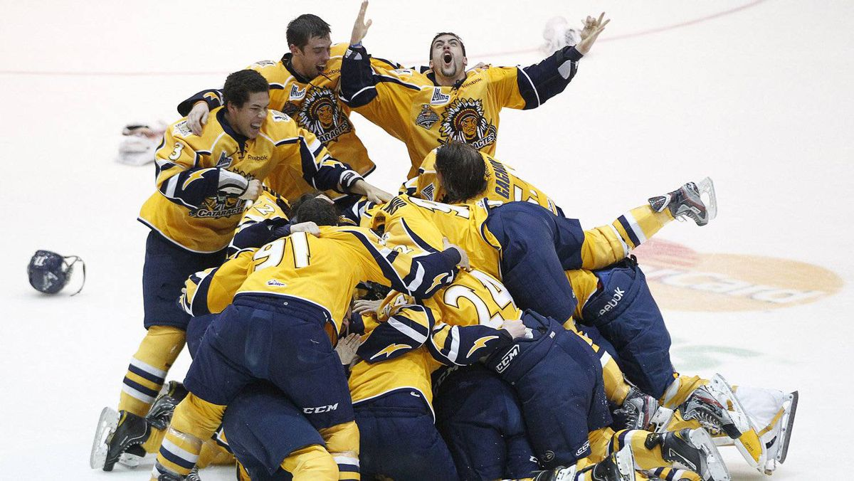 Shawinigan Cataractes players celebrate after defeating the London Knights during their Memorial Cup final ice hockey game in Shawinigan, Quebec, May 27, 2012. REUTERS/Mathieu Belanger