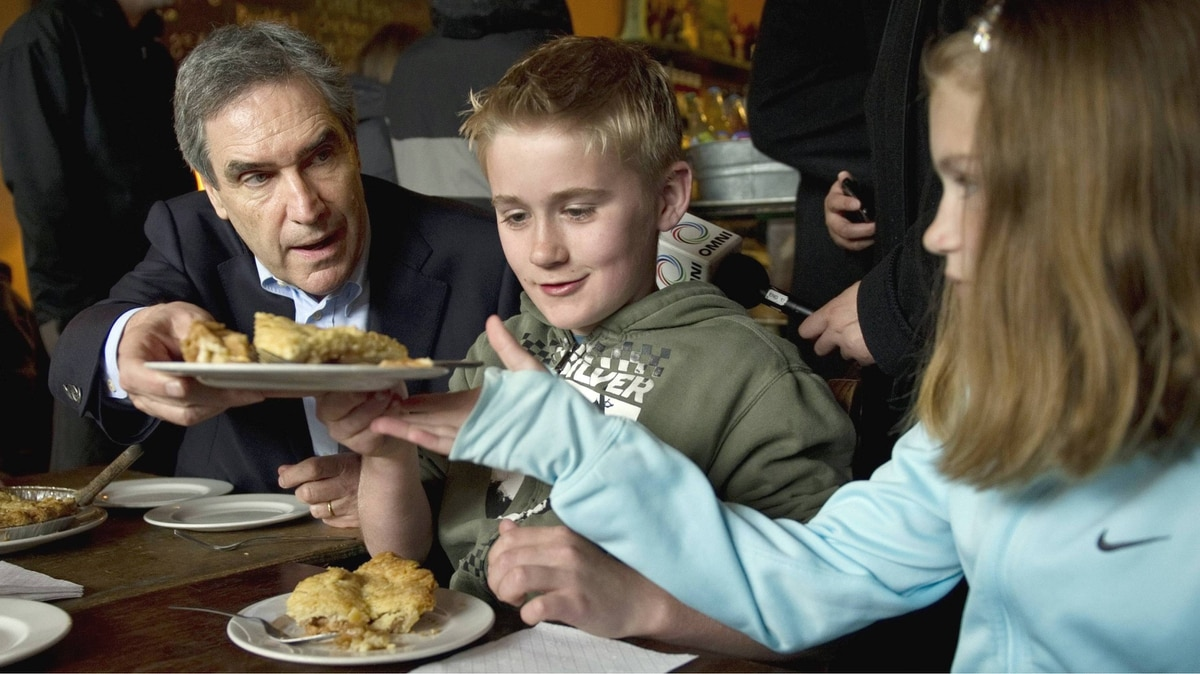 Liberal Leader Michael Ignatieff hands over a piece of pie to Lily Murphy, 9, as her brother Brien, 11, looks on at the Savary Island Pie Company Monday, April 25, 2011 in Vancouver.