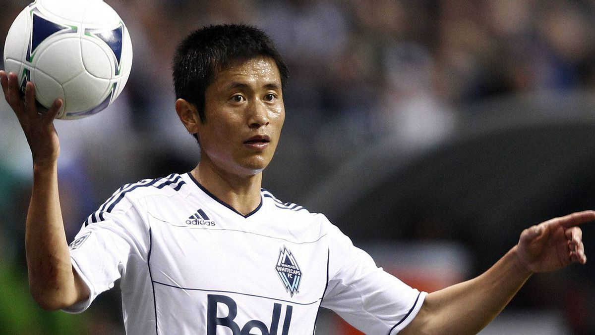 Vancouver Whitecaps Lee Young-pyo throws in the ball during the second half of their MLS soccer match against Montreal Impact in Vancouver, British Columbia March 10, 2012. REUTERS/Ben Nelms