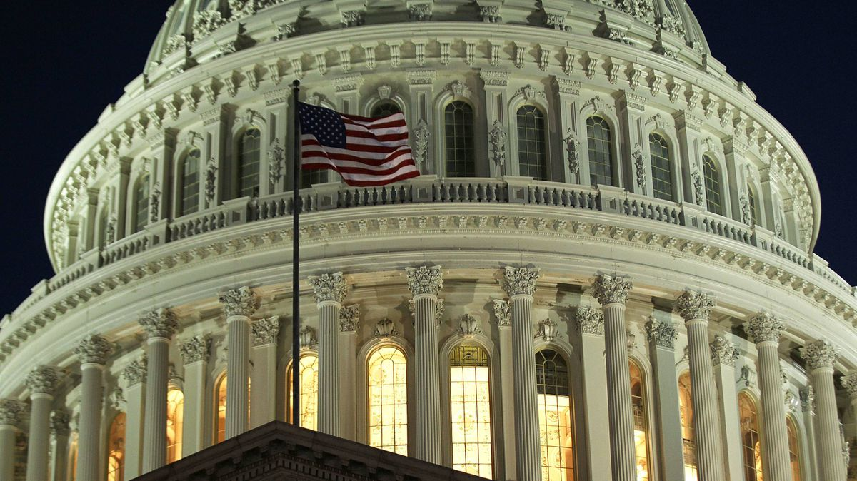 A U.S. flag flies at the Capitol July 30, 2011 on Capitol Hill in Washington, DC. Members of the Congress continued to debate on the debt ceiling plan.