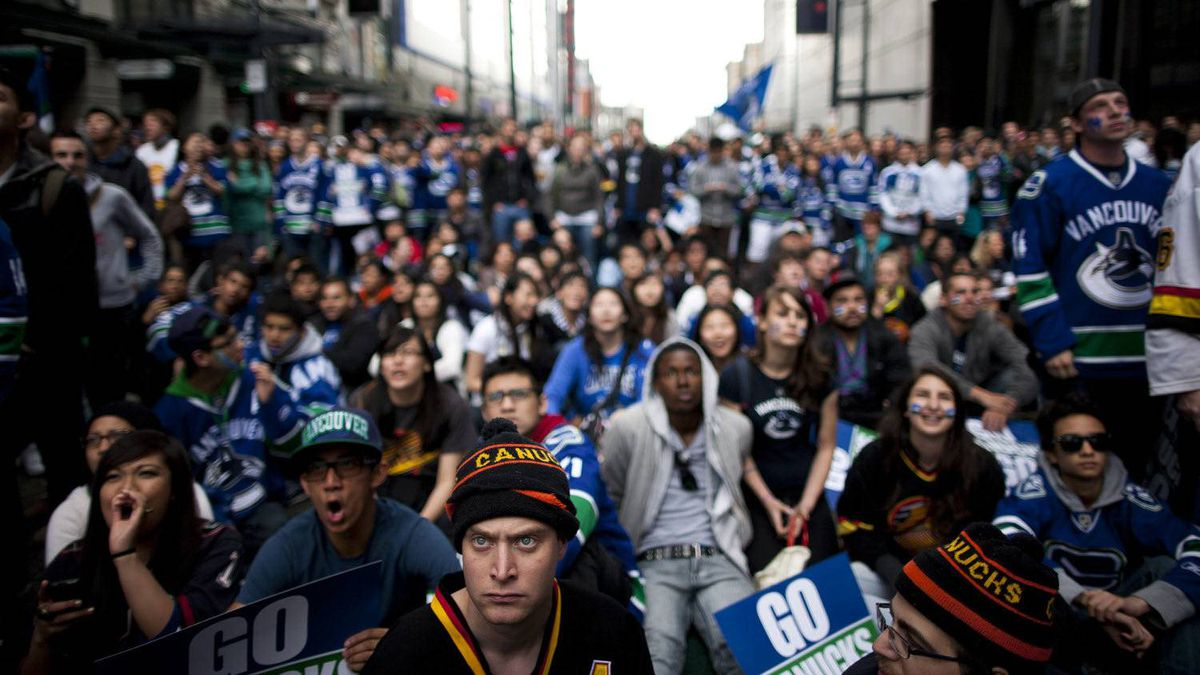 Canucks fans watch the first period in the first game of the Stanley Cup Final at West Georgia Street and Granville Street in Vancouver, British Columbia, Wednesday, June 1, 2011.