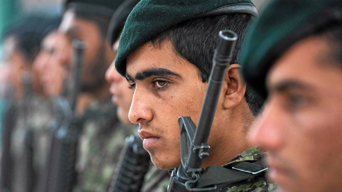 Afghan National Army soldiers attend a ceremony to hand over security control in the city of Charikar in Parwan province on Dec. 1, 2011.