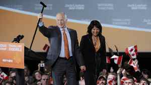 Canada's New Democratic Party (NDP) leader Jack Layton and his wife Olivia Chow greet supporters at his federal election night headquarters in Toronto, May 2, 2011.