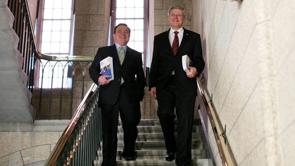 Prime Minister Stephen Harper (R) and Finance Minister Jim Flaherty (L) walk to the House of Commons to deliver the budget on Parliament Hill in Ottawa.