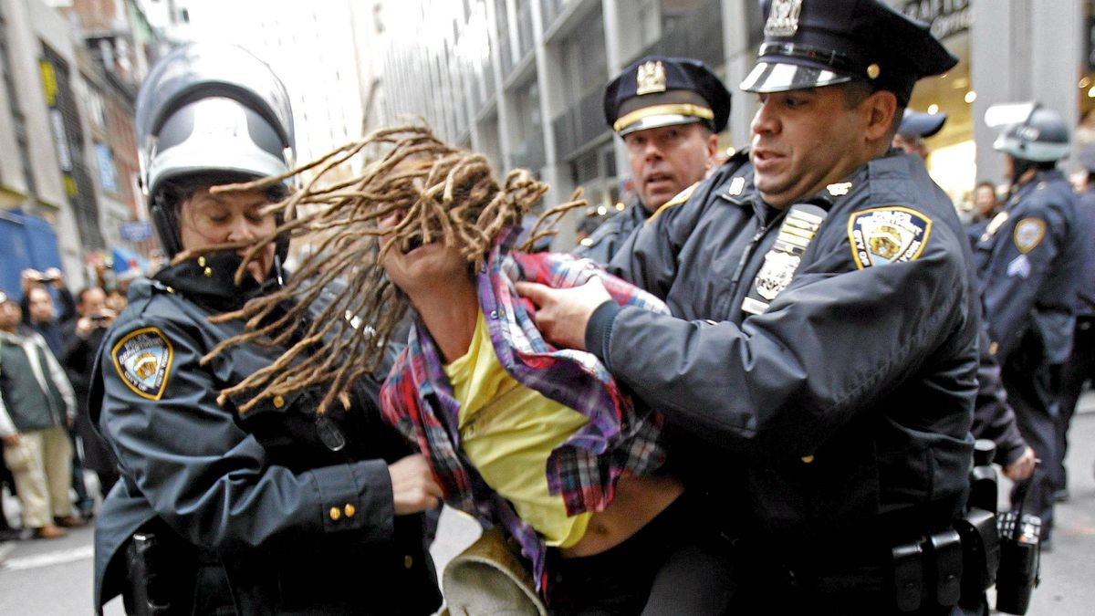 """An Occupy Wall Street demonstrator is arrested by New York City Police during what protest organizers called a """"Day of Action"""" in New York Nov. 17, 2011."""