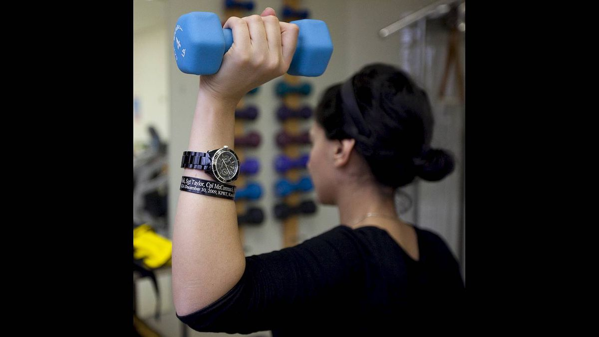 Bushra Saeed works through her daily physiotherapy routine at the Rehabilitation Centre in Ottawa. She wears a bracelet with the names of those lost in the bombing.