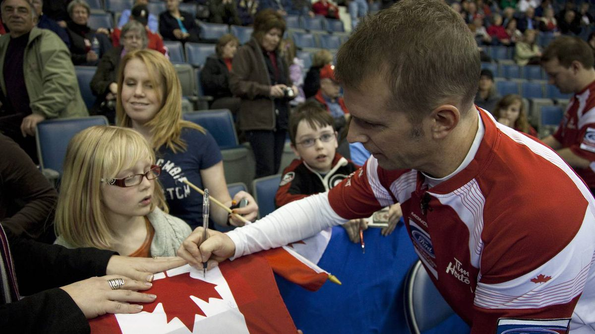 Team Canada skip Jeff Stoughton signs autographs after his teams 7-4 win over Germany at the Brandt Centre during the Ford World Men's Curling Championships in Regina Sunday, April 3, 2011. THE CANADIAN PRESS/Jonathan Hayward