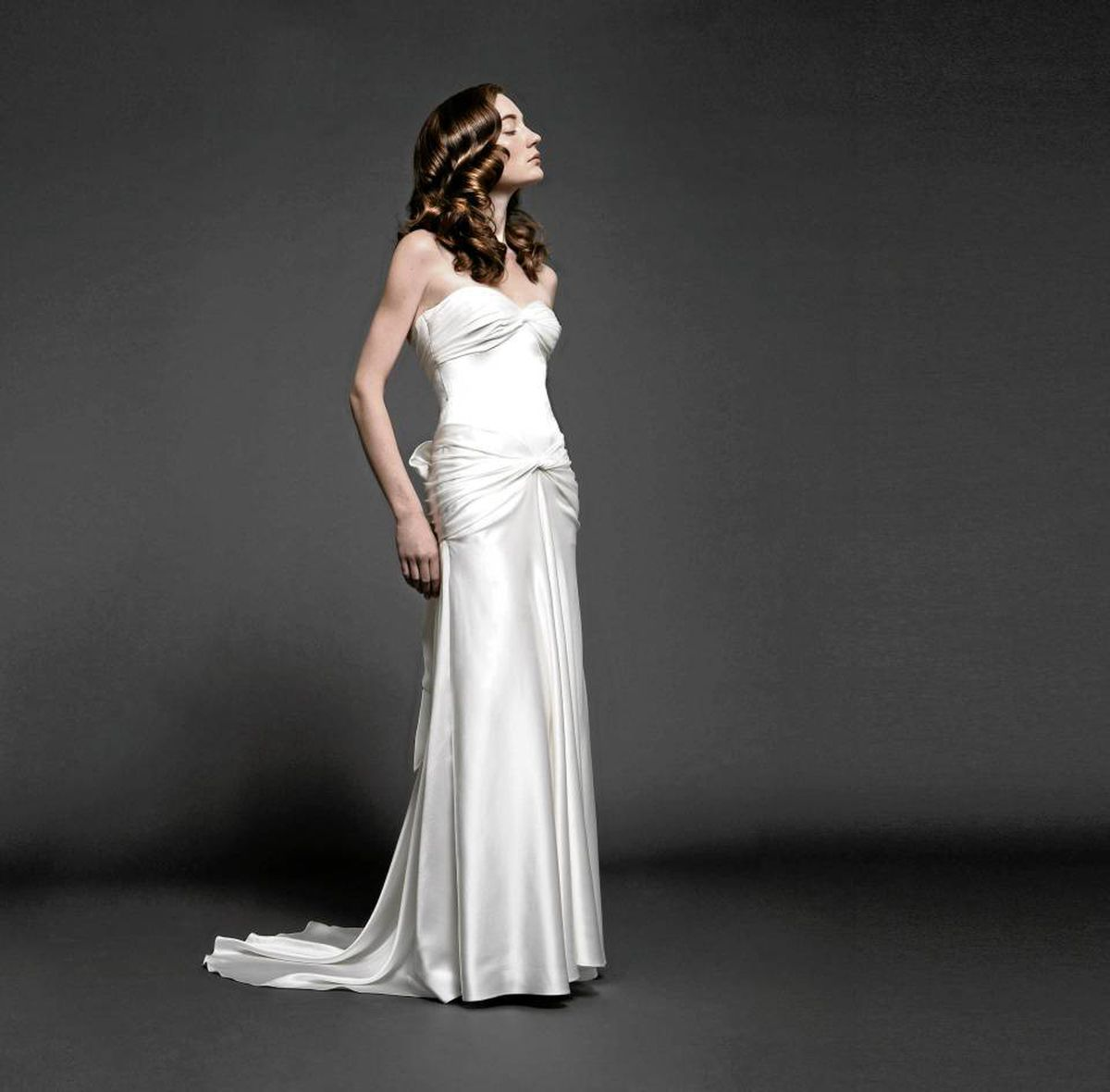 The Grecian goddess look as interpreted by Vera Wang and Elie Saab flatters fuller figures by giving the impression of a nipped waist. The gown pictured here is by Toronto designer Adele Wechsler, whose full collecation can be viewed at www.adelewechsler.com.