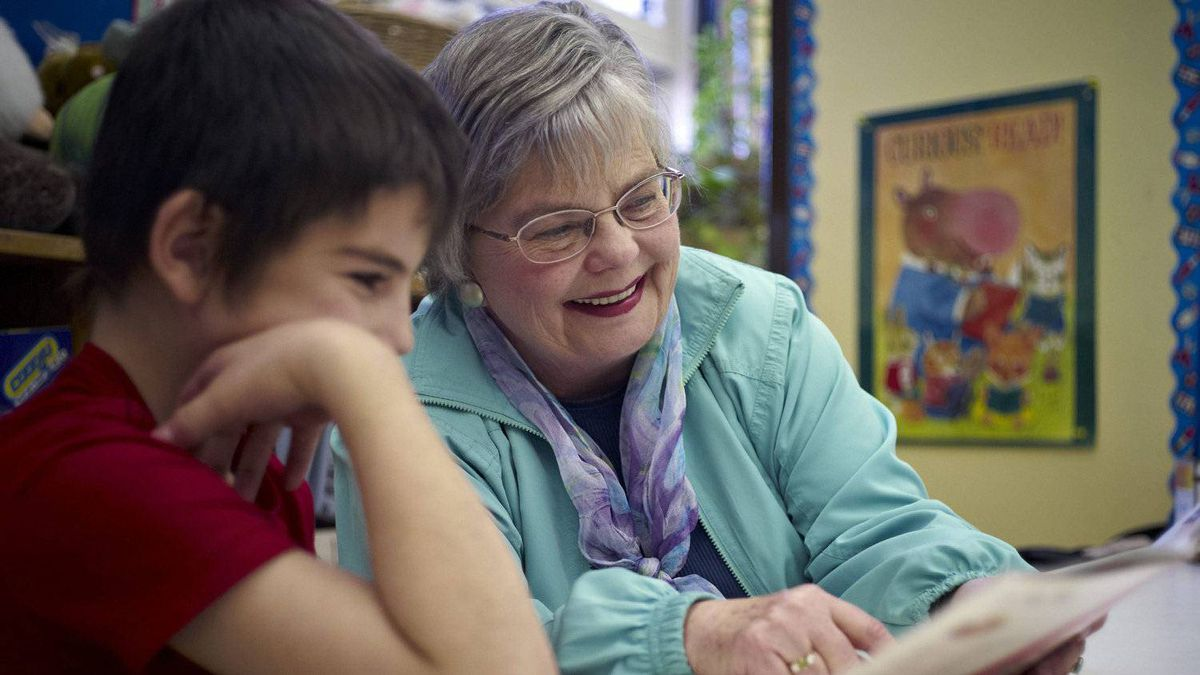 Elizabeth Marshall, right, tutors Hunter Harris, seven, in Calgary, Alta., Thursday, Oct. 27, 2011.