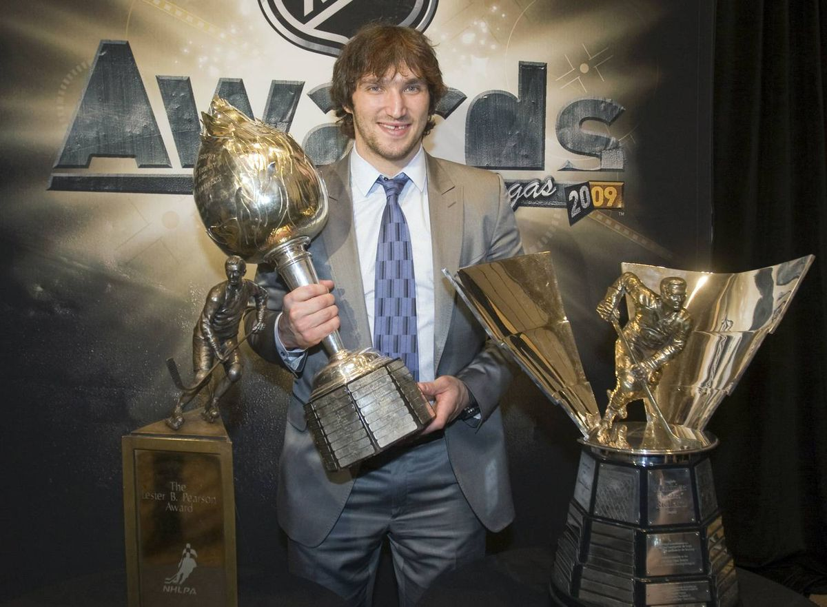 Washington Capitals winger Alex Ovechkin holds the Hart Memorial trophy as he poses with Lester Pearson Trophy and the Maurice Richard trophy at the National Hockey League awards in Las Vegas.