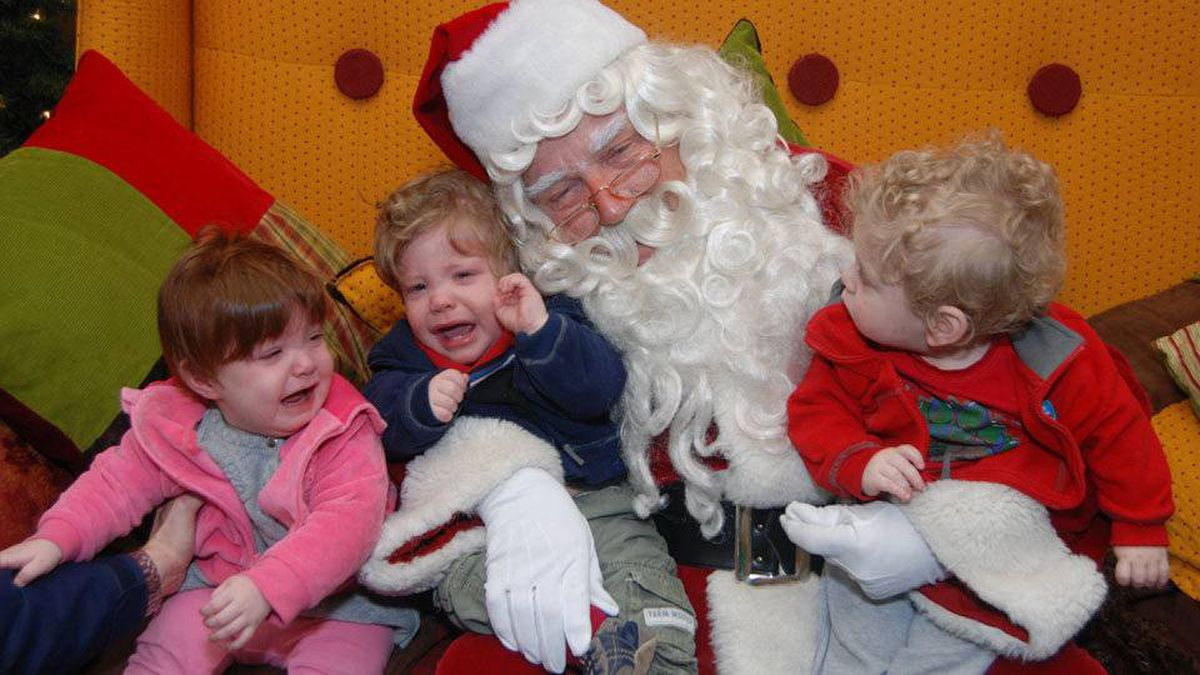 Edward Irving writes: Santa tries his best with 14 month-old triplets Colin, Keith and Evelyn Irving.