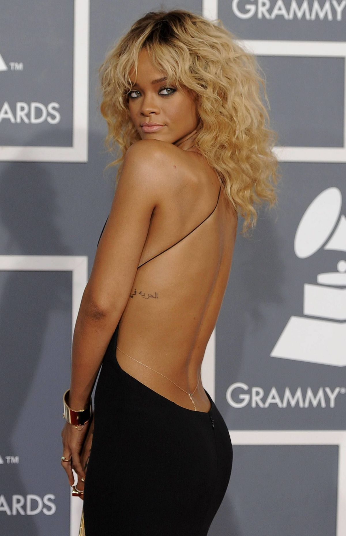 Rihanna arrives at the 54th annual Grammy Awards on Sunday, Feb. 12, 2012 in Los Angeles.