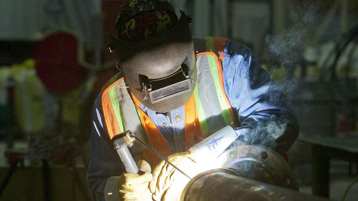 An employee welds some pipes at the ILevel plant in Kenora.