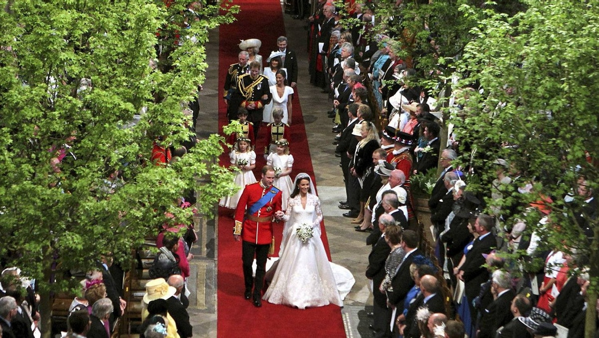 Britain's Prince William and his wife Catherine, Duchess of Cambridge, hold hands as they leave Westminster Abbey after their wedding ceremony in London April 29, 2011.
