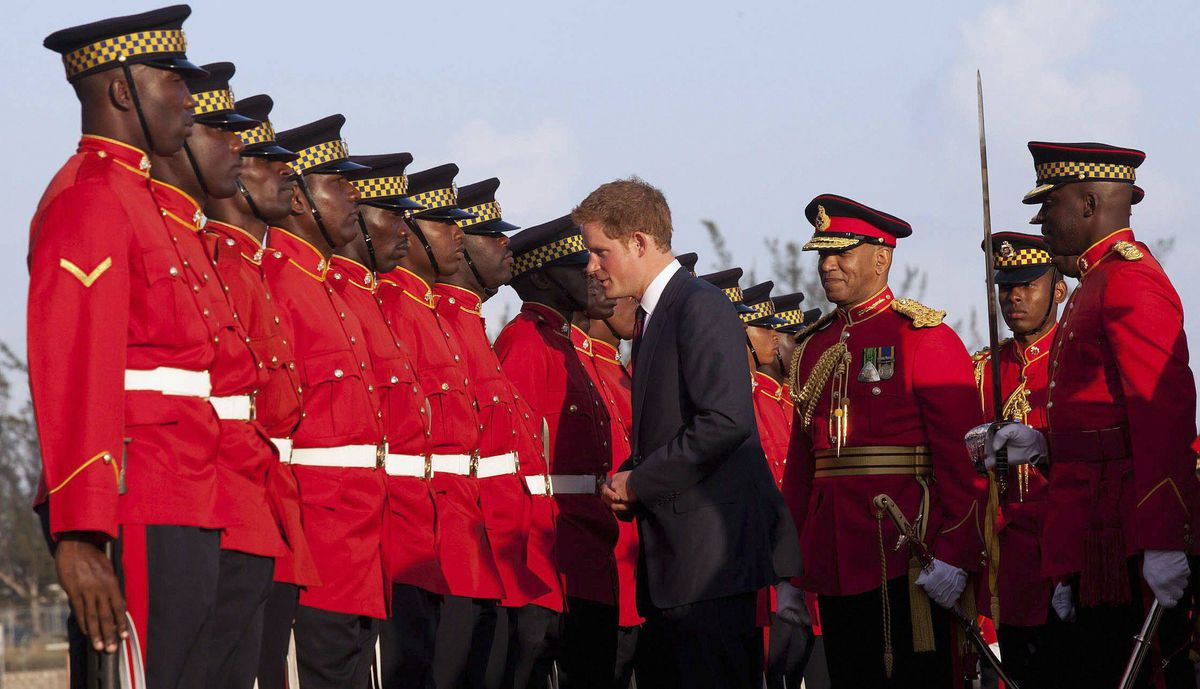 Prince Harry meets honour guards during the ceremony for his arrival at the Norman Manley International Airport in Kingston, Jamaica, March 5, 2012.