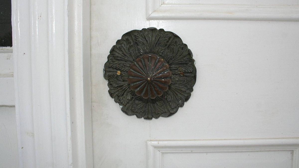 Detail of an intricate doorknob.