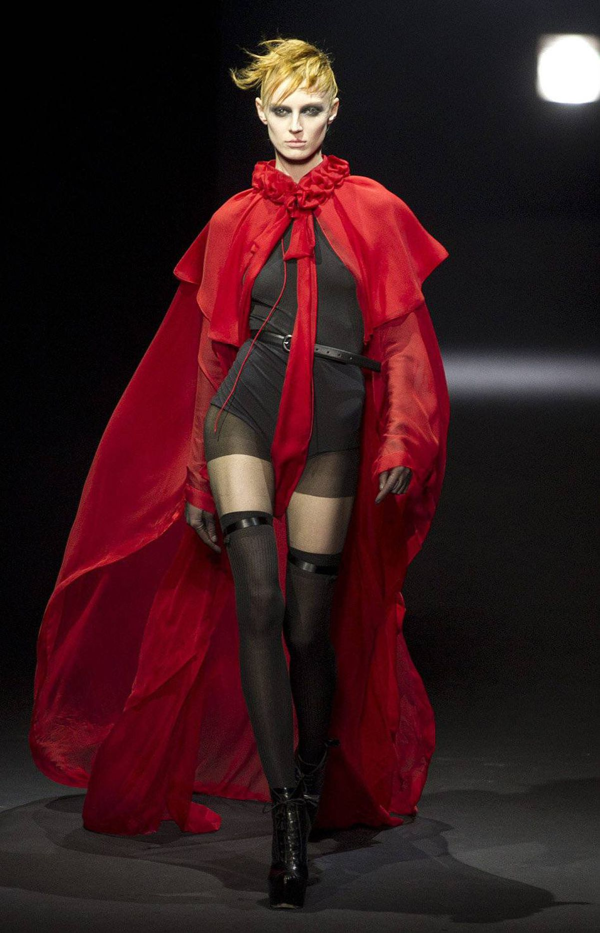 """And here is a boudoir version of Little Red Riding Hood. Oscar Wilde, a friend of Beardsley, famously said, """"One should either be a work of art, or wear a work of art."""" Alas, this collection was more overworked than wearable."""
