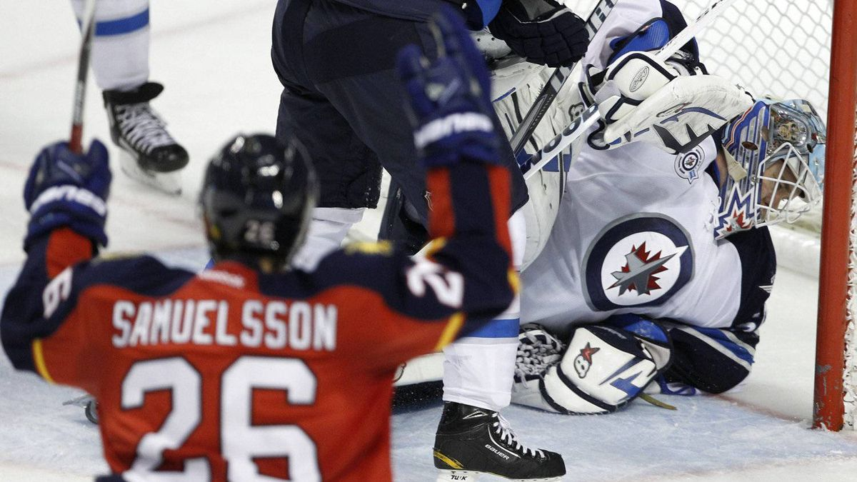 Florida Panthers right wing Mikael Samuelsson (26) reacts after the puck gets past Winnipeg Jets goalie Chris Mason, right, for a goal by Panthers left wing Sean Bergenheim during the second period during an NHL hockey game, Friday, Feb. 3, 2012, in Sunrise, Fla. (AP Photo/Lynne Sladky)