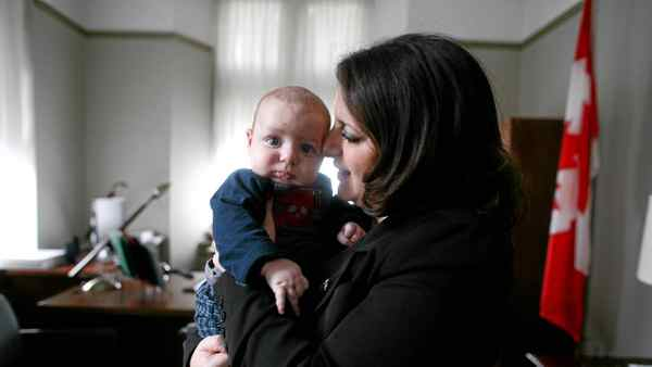NDP MP Sana Hassainia with her three month old baby Skander-Jack Kochlef in her office on Parliament Hill in Ottawa.