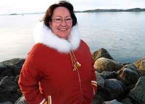 Sheila Watt-Cloutier stands on a breakwater in Iqaluit.