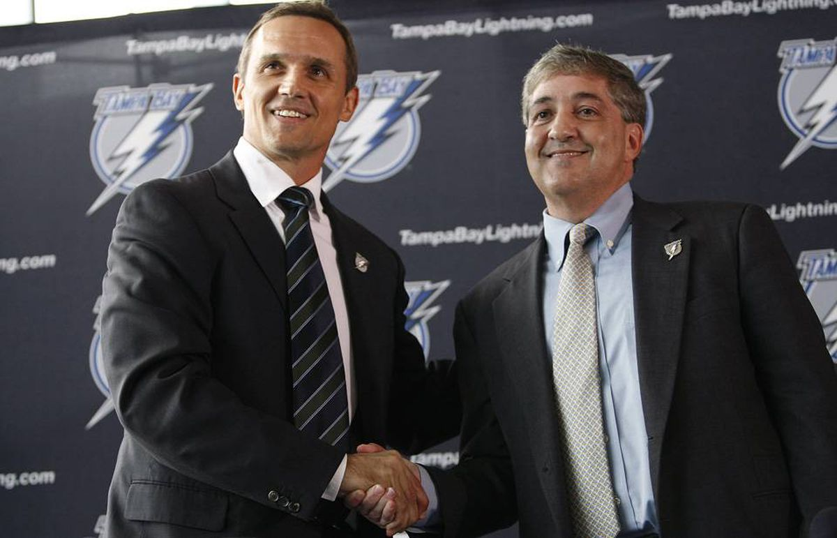 Tampa Bay Lightning owner Jeff Vinik shakes hands with former Detroit Red Wings vice-president Steve Yzerman after announcing Yzerman as the Lightning's new general manager during a news conference in Tampa.