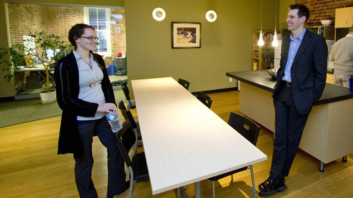 Latitude Geographics Group product support analyst Victoria McDonald, left, and company founder and CEO Steven Myhill-Jones in the company kitchen. Ms. McDonald was brought on as an intern, and then hired as a permanent employee.