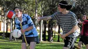 In a picture taken on June 26, 2011 chaser Jacob Warnock (L) is hit by a bludger throwing opponent (R) while training for Muggle Quidditch, based on J.K Rowling's 'Harry Potter' books and films, in Sydney.
