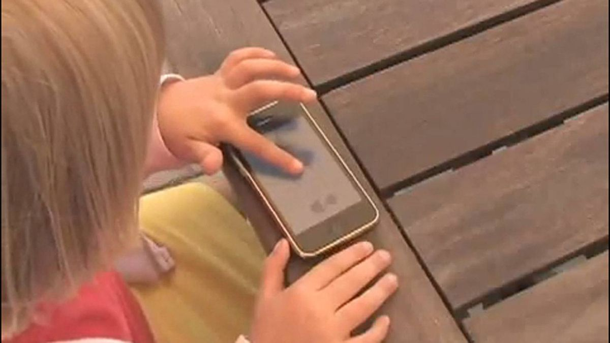 A child plays a game from Tickle Tap Apps.