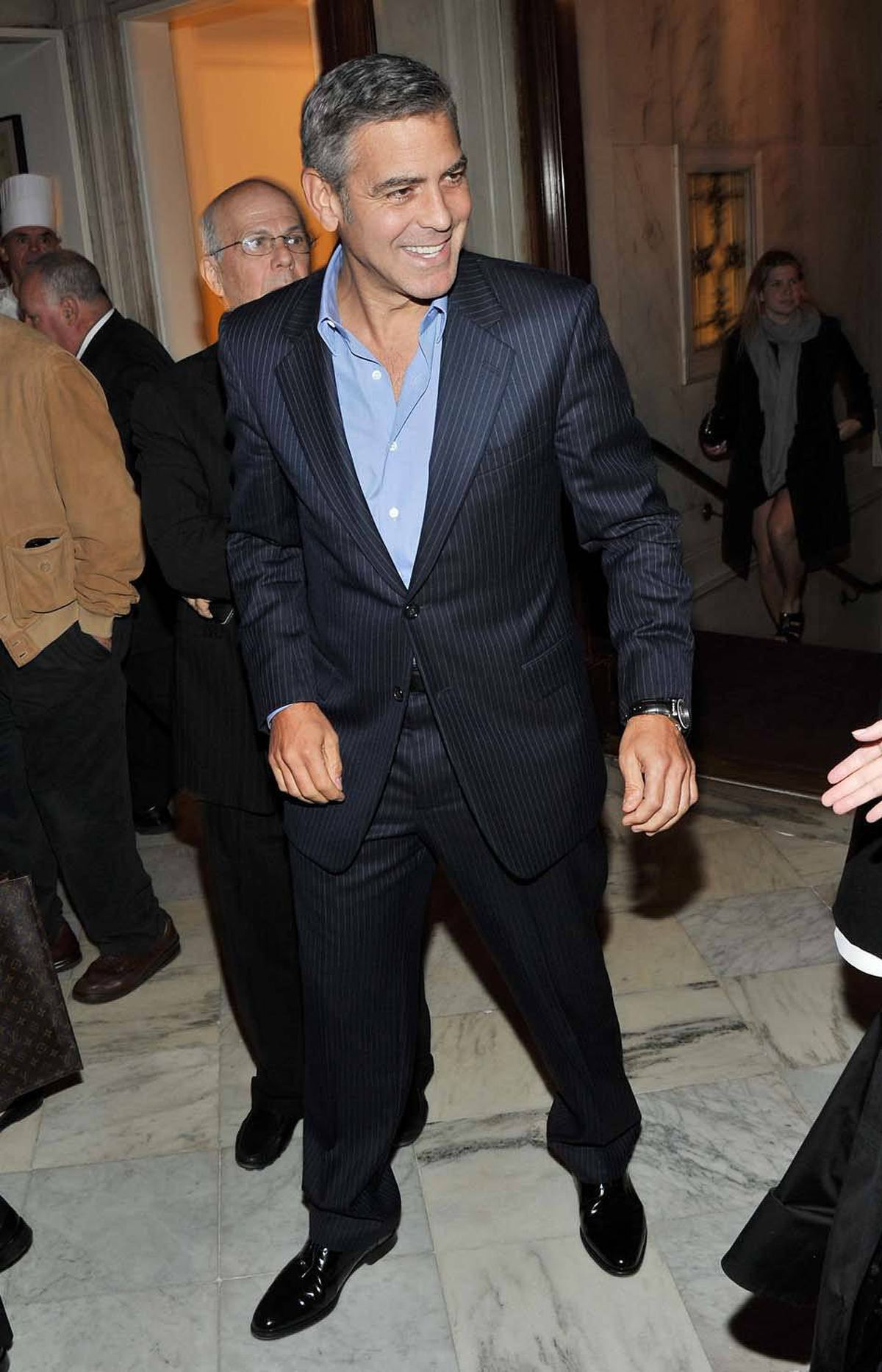 """Left-leaning actor/director George Clooney attends the after-party for the premiere of """"The Ides of March"""" in a swank and exclusive club in Manhattan last week. He said last week he would pay more attention to the Occupy Wall Street movement were he not so busy attending events like this. Seriously. That's what he said."""
