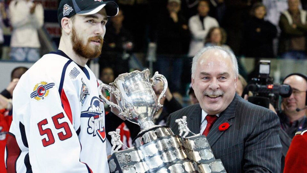 CHL Commissioner David Branch presents the CHL Memorial Cup to Harry Young #55 of the Windsor Spitfires during the 2009 Mastercard Memorial Cup Final at the Rimouski Colisee on May 24, 2009 in Rimouski, Quebec, Canada. The Spitfires defeated the Rockets 4-1 winning the 2009 Memorial Cup.