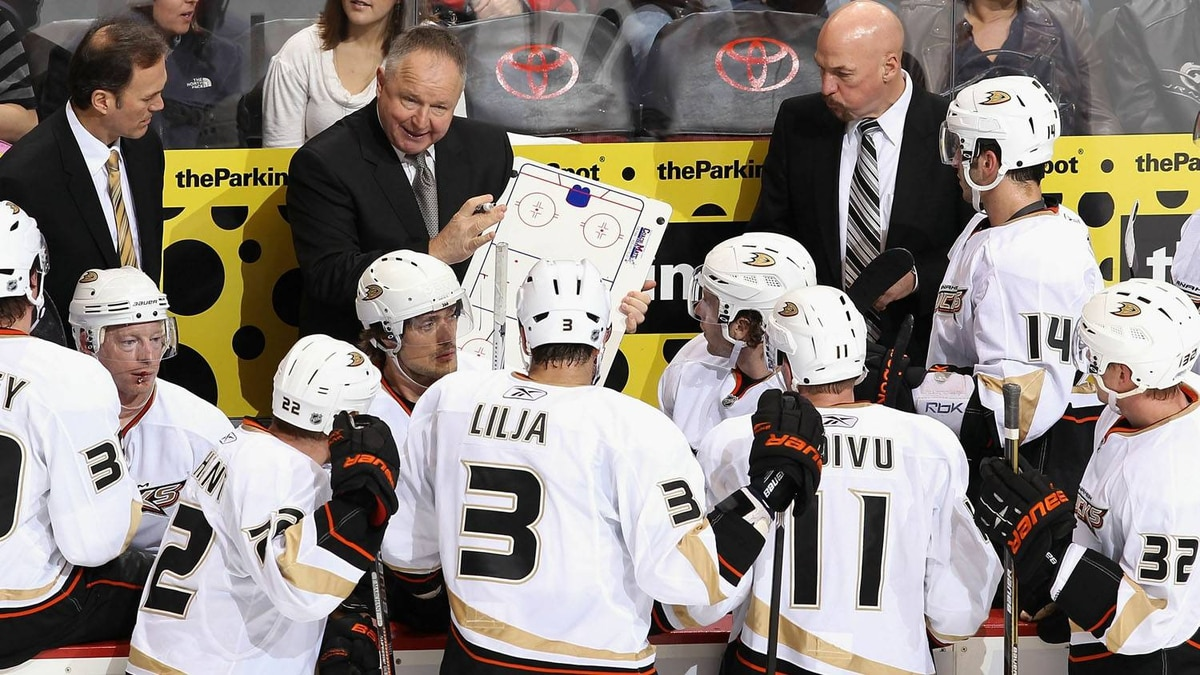 Head coach Randy Carlyle of the Anaheim Ducks talks with his team during a time out from the NHL game against the Phoenix Coyotes at Jobing.com Arena on January 15, 2011 in Glendale, Arizona. The Coyotes won 6-2. (Photo by Christian Petersen/Getty Images)