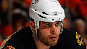 Nathan Horton of the Boston Bruins suffered a severe concussion after a violent hit the Canucks Aaron Rome five minutes into the Game 3 of the Stanely Cup. (Photo by Paul Bereswill/Getty Images)
