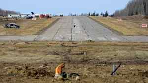 Employees work at the new Devon airport near Conklin, Alta., October 28, 2011.