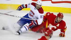Montreal Canadiens' Max Pacioretty, left, crashes down on Calgary Flames' Mark Giordano during second period action in Calgary March 6, 2012.
