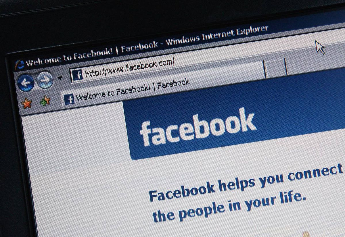 Social-networking site Facebook is displayed on a laptop screen.