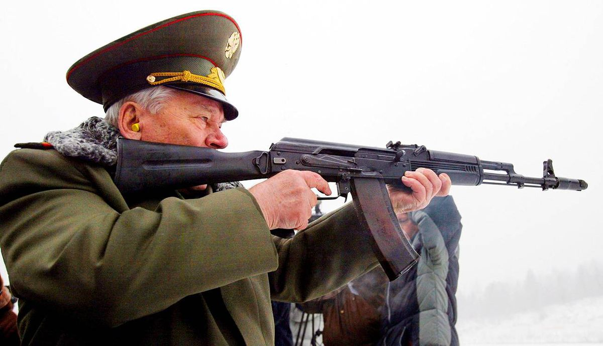 Russian designer Mikhail Kalashnikov, the creator of the world's most famous assault rifle, the AK-47, aims a current version of his weapon.