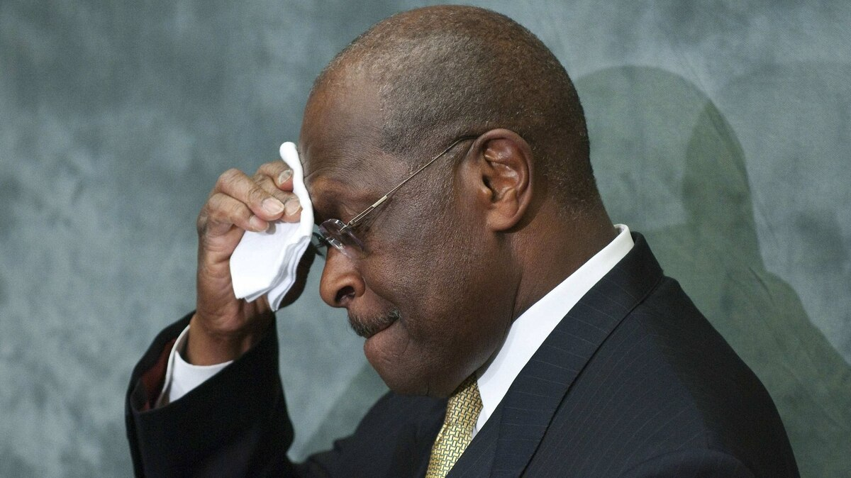 Republican presidential candidate Herman Cain wipes his brow during remarks to legislators in the Congressional Health Care Caucus on Capitol Hill in Washington on Nov. 2, 2011.