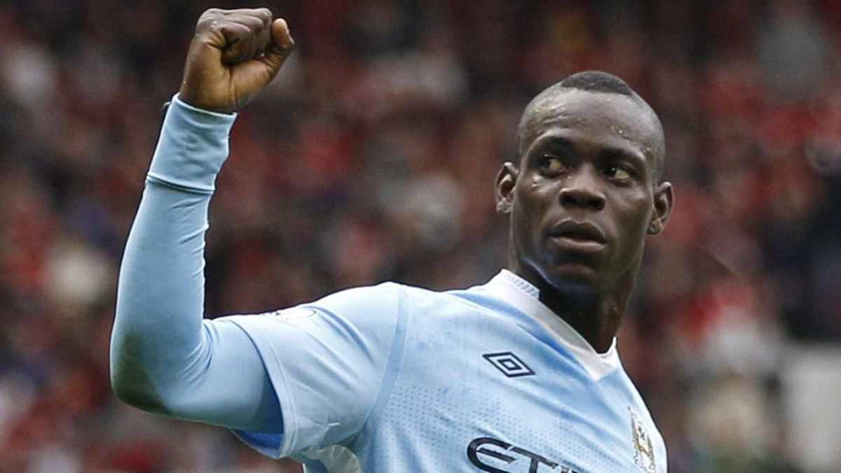 Manchester City's Mario Balotelli celebrates after scoring against Manchester United during their English Premier League soccer match at Old Trafford in Manchester on Sunday.