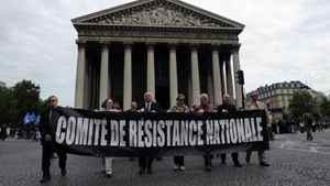 """Members of French far right organizations take part in a protest march in Paris May 8, 2011. About 500 protesters marched on Sunday against France's government and its immigration policies. The banner reads: """"Committee of national resistance""""."""