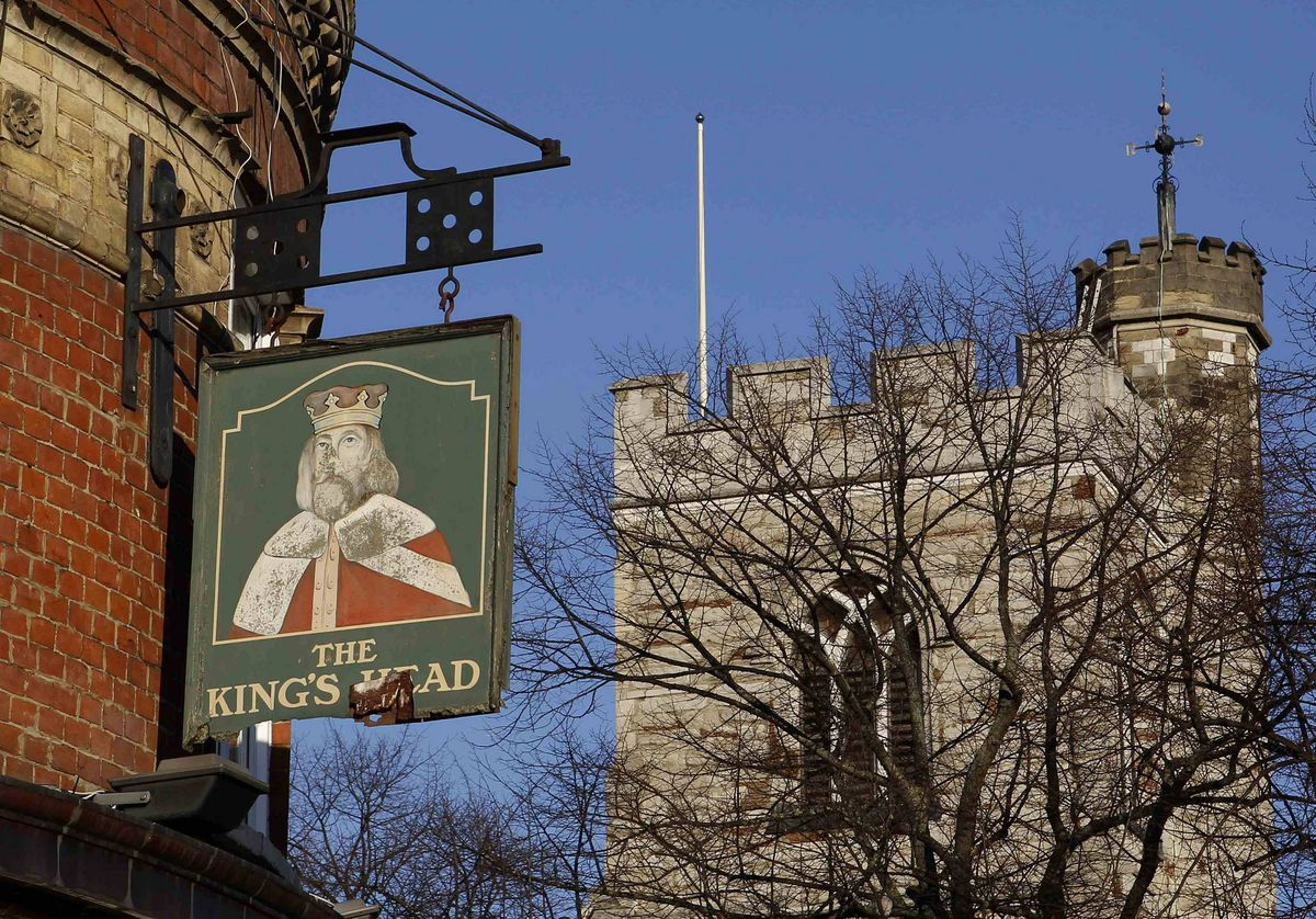 A sign is seen outside the King's Head hotel in east London. Dating from 1900, the owners changed the property in 2007 to a hotel but kept the pub sign outside.