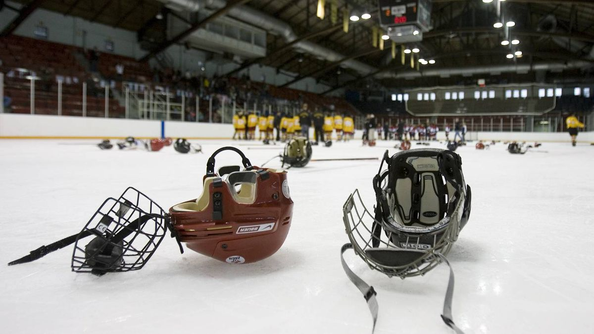 Helmets, gloves, and sticks litter the ice after being discarded by the winning team during their end-of-game celebrations. (Photo by Peter Power/The Globe and Mail)