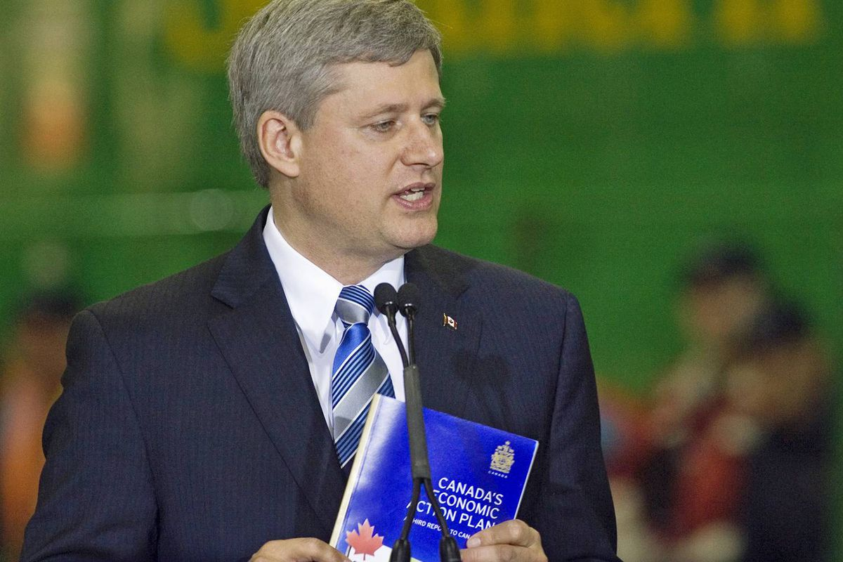 Prime Minister Stephen Harper releases his government's latest economic update at the Irving-owned NB Southern Railway mechanical shop in Saint John on Sept. 28, 2009.