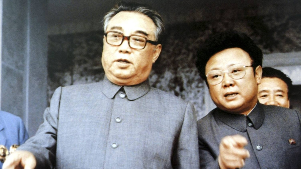 Kim Il-sung (L), founder of North Korea, chats with his son Kim Jong-il at a mass rally to celebrate the foundation of the communist country in Pyongyang in this September 1983 photograph.