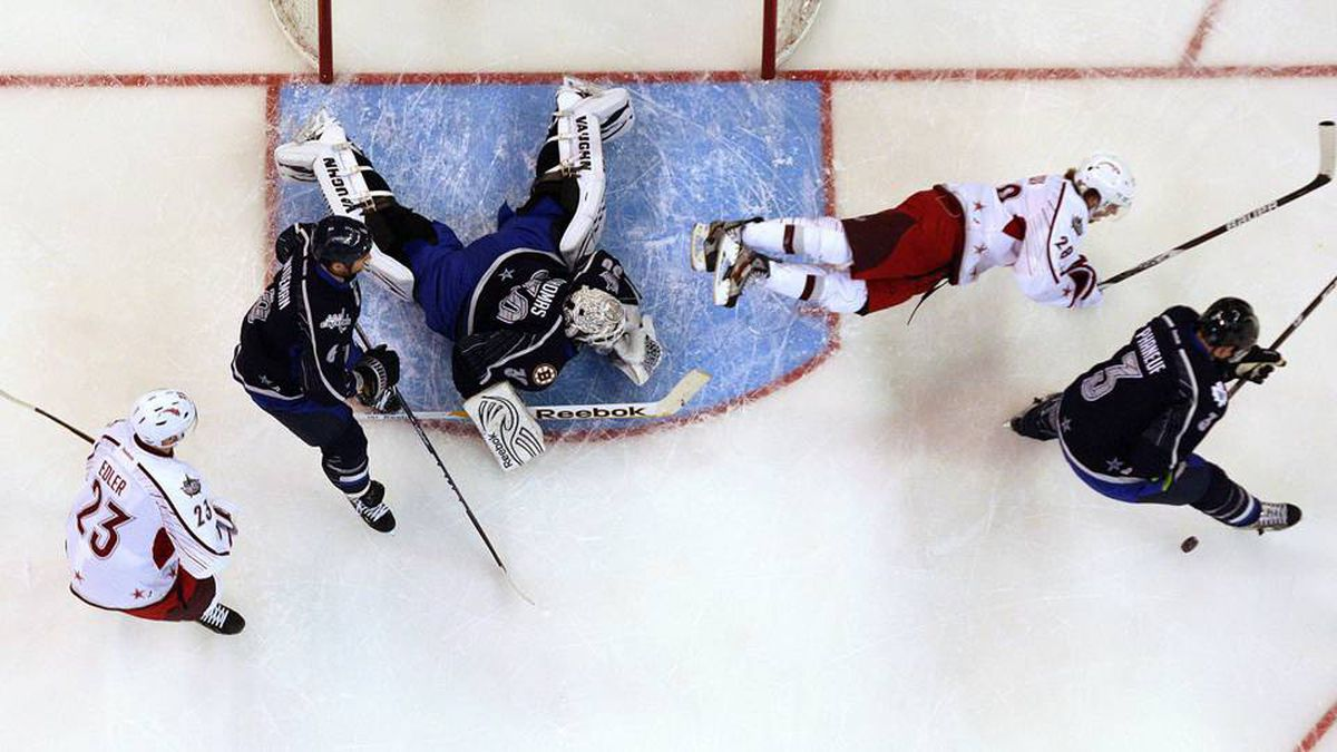 Team Alfredsson's Claude Giroux, of the Philadelphia Flyers, flies over Team Chara goaltender Tim Thomas, of the Boston Bruins, during the NHL all-star game competition in Ottawa on Sunday.