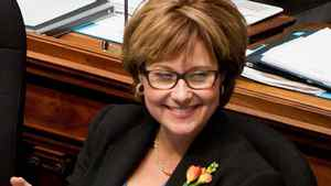 British Columbia Premier Christy Clark applauds as Finance Minister Kevin Falcon pauses while tabling the provincial budget at the B.C. Legislature in Victoria, B.C., on Tuesday February 21, 2012.