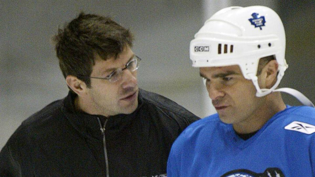 Worldstars coach Marc Bergevin chats with Tie Domi of the Toronto Maple Leafs during a practice on Dec. 7, 2004 in Toronto.