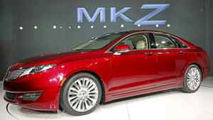 The 2013 Lincoln MKZ automobile is seen during a news conference in New York, April 2, 2012. Ford Motor Co is rolling out new Lincoln models with a panoramic glass roof option to lure younger, more affluent buyers, as the No. 2 U.S. automaker tries to revive a luxury brand whose sales peaked two decades ago. The 2013 Lincoln MKZ sedan will be unveiled at the New York auto show this week, one of seven new or revamped Lincoln models to be rolled out by 2015. REUTERS/Shannon Stapleton (UNITED STATES - Tags: TRANSPORT BUSINESS)
