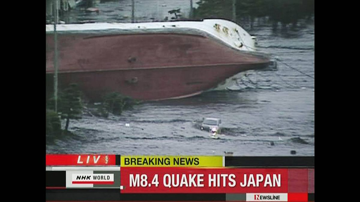 Frame grab of an overturned boat following a tsunami in Hachinohe